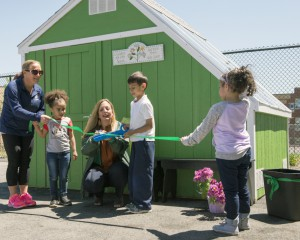 Breen Students Cutting Ribbon In front of New Greenhouse