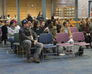 group seated at community forum