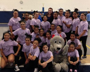 Guilmette Cheer Team posing with Mascot