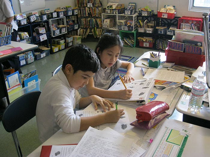2 Students working on packet