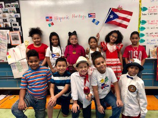 students holding up a puerto rican flag