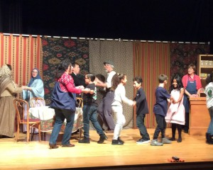 "Wetherbee Grade 4 students perform on stage with cast members from ""In Good Company"""