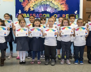 Ambassadors of Peace recipients posing with certificates