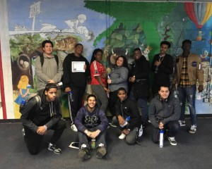 HLC Blue Ambassadors in front of mural
