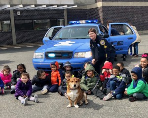 Autism Awareness Patrol Car with students from the Hennessey