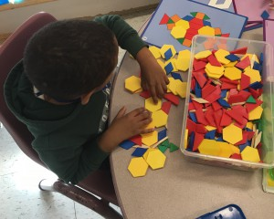 Student organizing colorful shapes