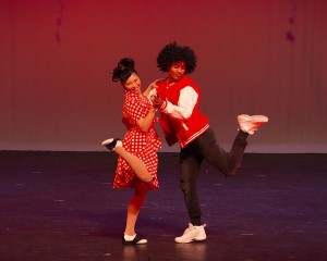 couple dancing Jive in red and white 50s costumes