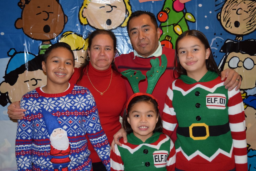 Family wearing holiday sweaters