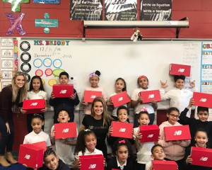 Mrs. Briody's students show off their new shoes from New Balance.