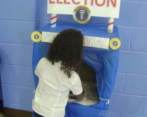 Student voting at blue station