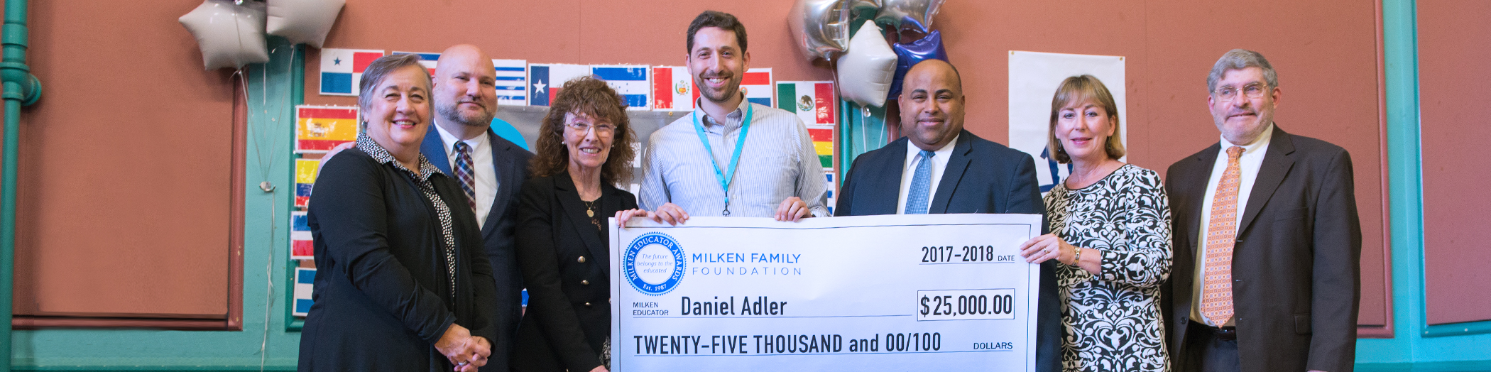 Group with Daniel Adler holding check